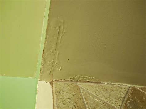 water damage in bathroom ceiling floor how to treat and