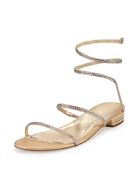 flat gold snake rene caovilla snake coil flat sandals in metallic