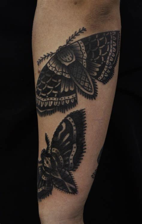 black ink moth tattoo  sleeve