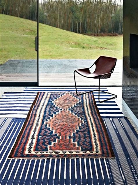 layering rugs 10 tips to help you master layering rugs