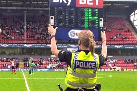 Policewoman saves the day at Grimsby Town vs Wigan ...
