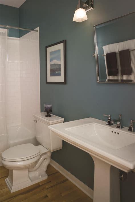 simple bathroom remodel ideas wood floors pedestal sink and teal walls the