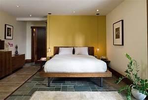 Unassuming bedroom with bedside pendant lights