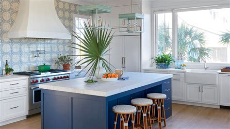 white kitchen with blue backsplash 11 beautiful blue kitchens coastal living 1832
