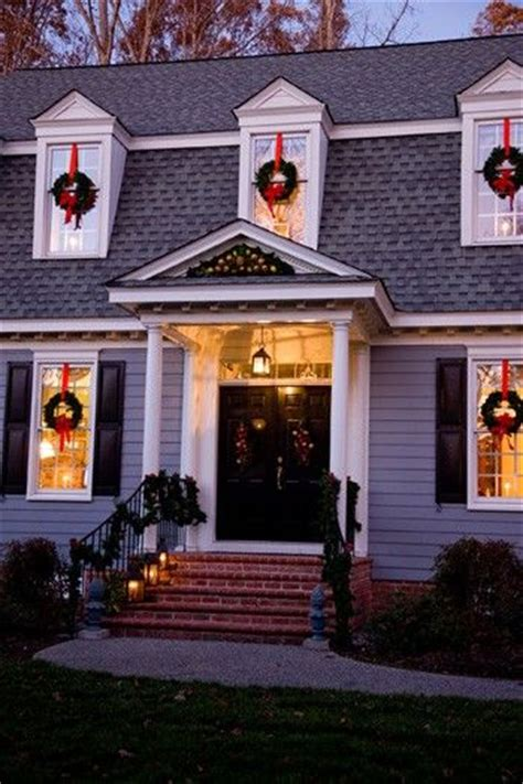 wreaths hanging   red ribbon   window holiday