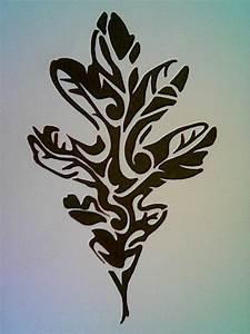 Black ink stylized leaf shaped tattoo - Tattoos photos