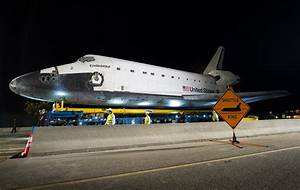 Look High — Shuttle Crossing The space shuttle Endeavour is...