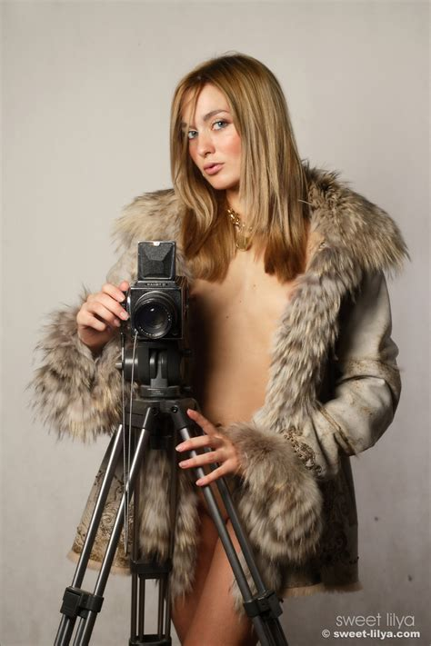 Charming Gadget Exposing The Hot Body Covered By Nothing But The Fur Coat