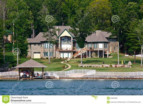 Boat Graphics Poole by Waterfront Mansion With Pool Boat Jet Skis Royalty Free