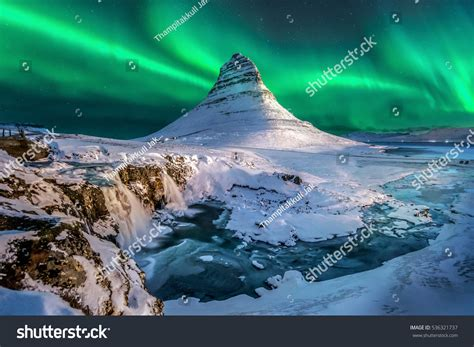 Northern Lights Appear Over Mount Kirkjufell Stock Photo