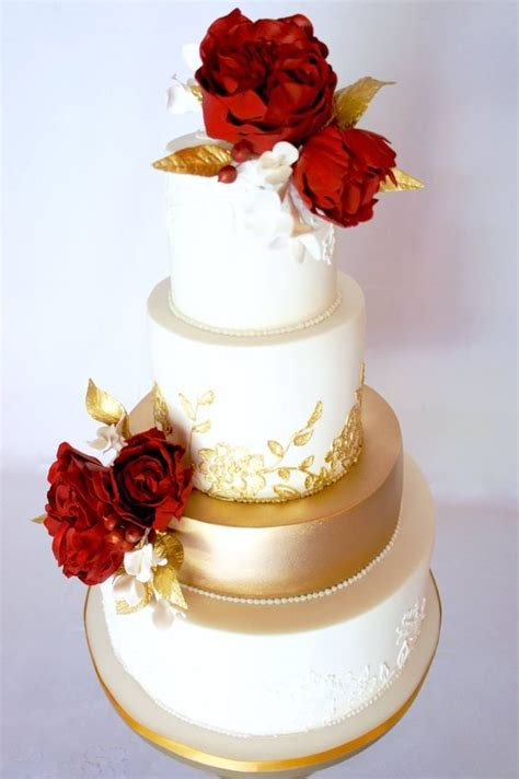 red flower topped gold  white wedding cake wedding
