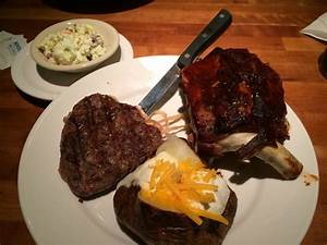 Half Rack Of Ribs With Sirloin Steak  Loaded Baked Potato And Coleslaw