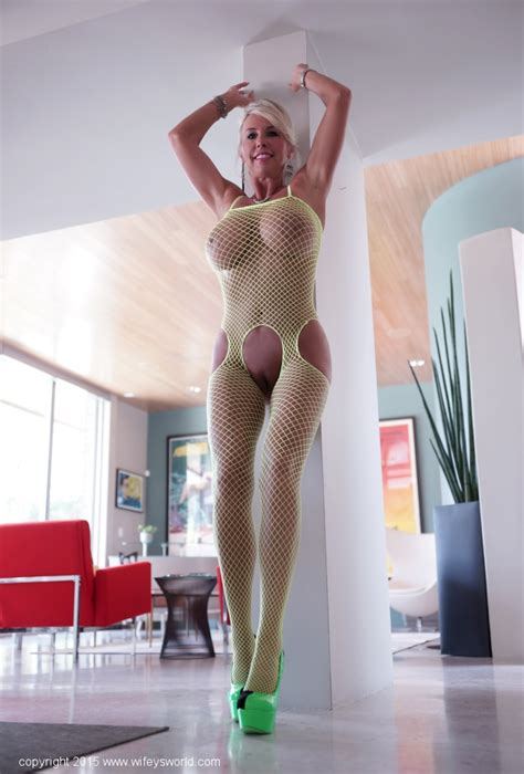 Gorgeous Milf With Huge Tits In Fishnet Bodysuit