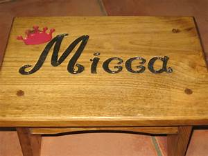engraved a stepstool by making a stencil and carving out With dremel letter templates