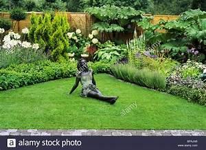 Garden with bronze figure sandringham flower show small for Designer gardens landscaping