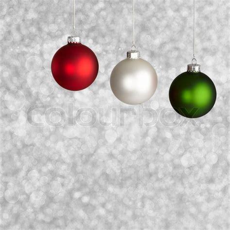 white red  green christmas ornaments  silver bokeh