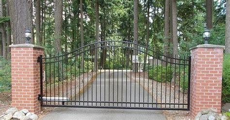 single swing gate  posts wrapped  brick masonry