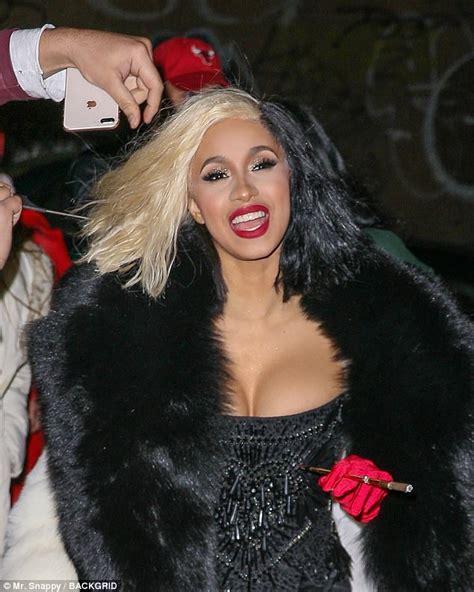 Cardi B sizzles in busty Cruella de Vil Halloween costume ...