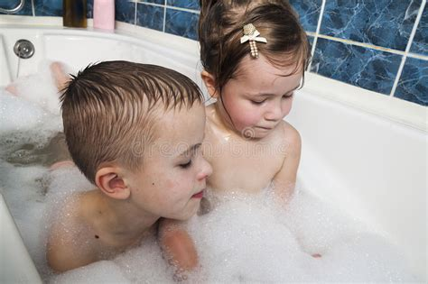 Brother And Sister Taking A Bubble Bath Little Boy And