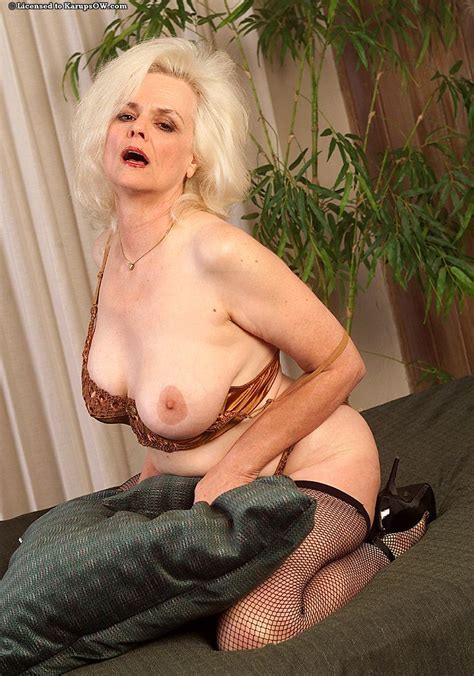 mature blond model zoe zane in stockings and shoes shows her big titties
