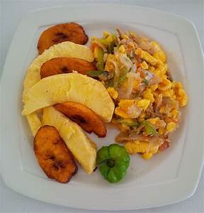 Ackee and Saltfish served with fried plantains and ...