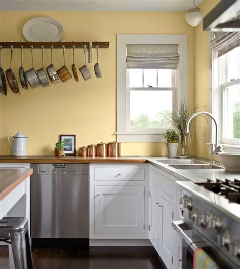 Pale Yellow Walls, White Cabinets, Wood Counter Tops