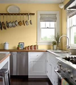 Pale yellow walls white cabinets wood counter tops for Kitchen colors with white cabinets with cubs wall art