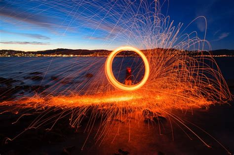 playing  fire steel wool spinning   landscape