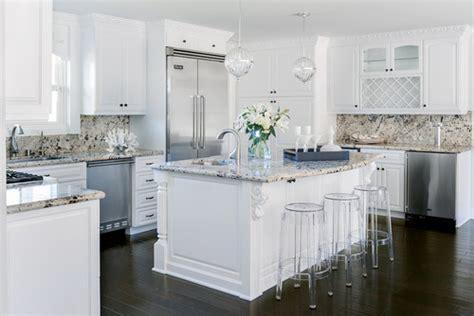 island in the kitchen white kitchen cabinets white granite countertops 4823