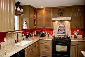 tuscan kitchen decor above cabinets the clayton design With best brand of paint for kitchen cabinets with construction themed wall art