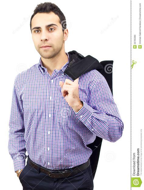 business man holding  coat  shoulder stock photo