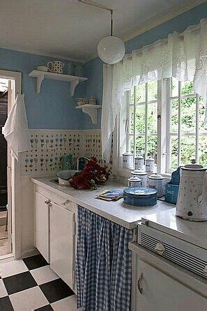 Blue themed country style vintage kitchen, checkerboard