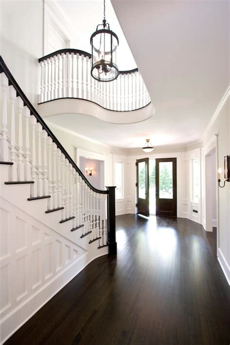 Grand formal foyer with dark hardwood floors and double