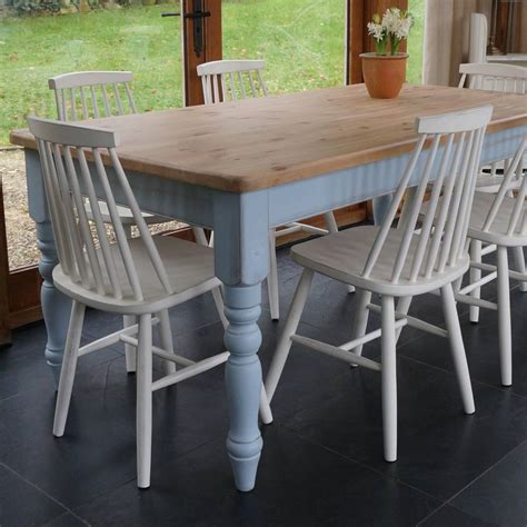 farmhouse table and 1960 s style chairs painted by