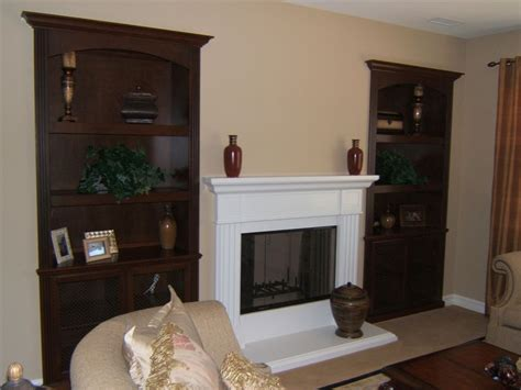 cabinets next to fireplace custom cabinetry built into niches next to fireplace c
