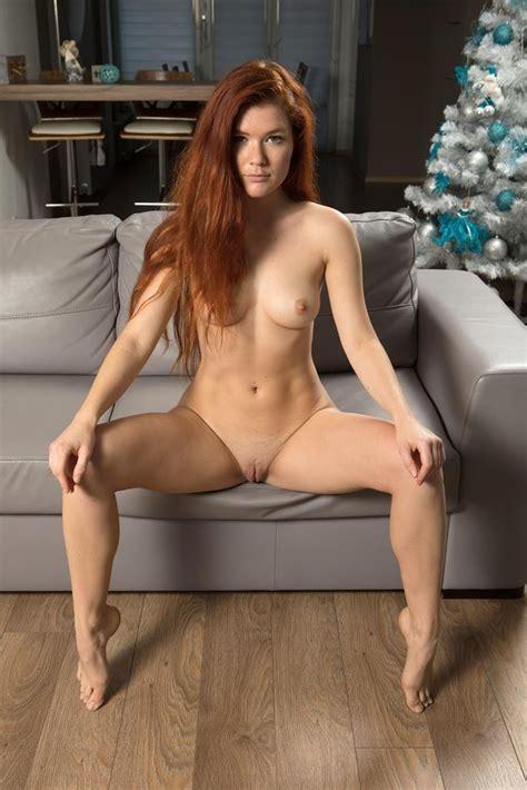 Redhead Beauty Likes Posing Nude On The Sofa