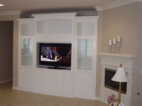 using kitchen cabinets for entertainment center get your own custom wall unit built in cabinets by 9575