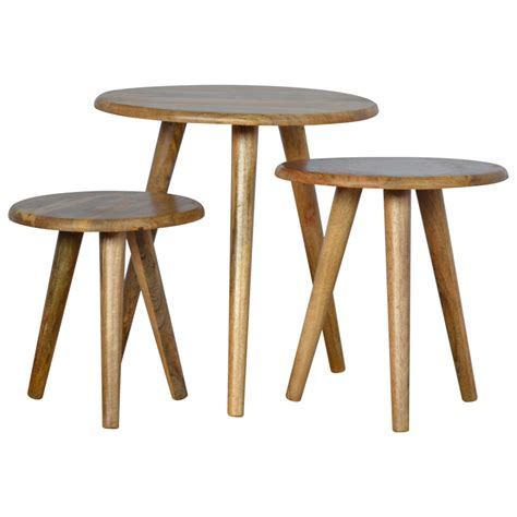 This coffee table has a narrow flat base that provides good stability on the ground. Solid Oak Finished Mango Wood Scandinavian Style 3PC Nest of Tables - Mango Wood Furniture