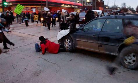 Car drives through Ferguson protest in Minneapolis, runs ...