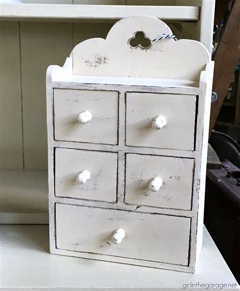 painted wooden storage boxes girl   garage