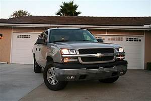 How To Replace A Chevy Avalanche Headlamp