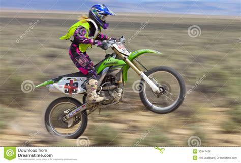 motocross racing in california dirt bike racer wheelie editorial photo image of desert