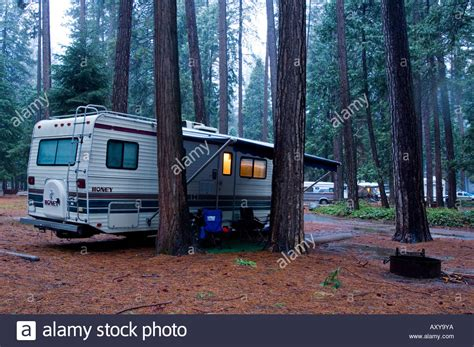 rv camper camping  forest  spring rain storm north pines stock photo royalty  image