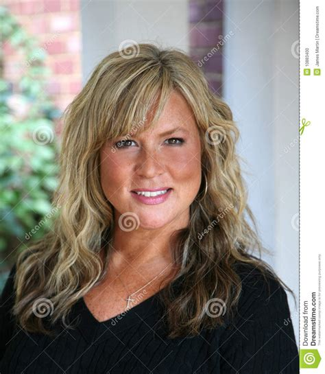 Attractive Mature Blond Haired Business Woman Stock Photo