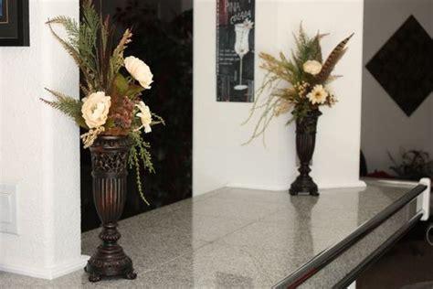 hand  silk flower arrangement fireplace mantel decor