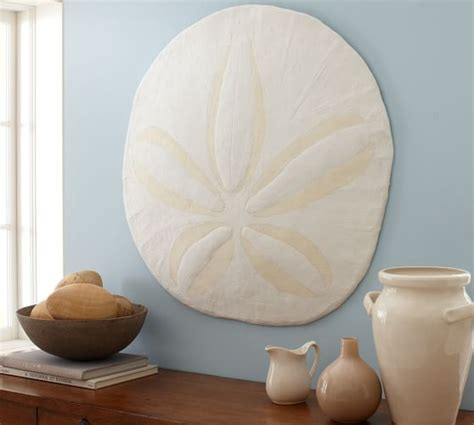 I ran across an oversized sand dollar in the april 2011 pottery barn catalog with a $99.00 price tag. Oversized Sand Dollar | Wall Decor | Pottery Barn