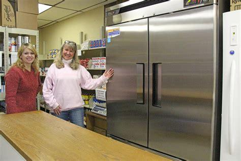 mvec donates refrigerators  jordan food shelf