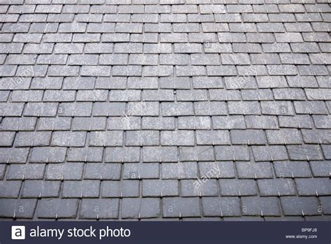slate roof tiles on house in stock photo