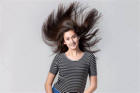 girl  flying hair stock photo  fizkes