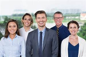 Successful Business Team Smiling at Camera